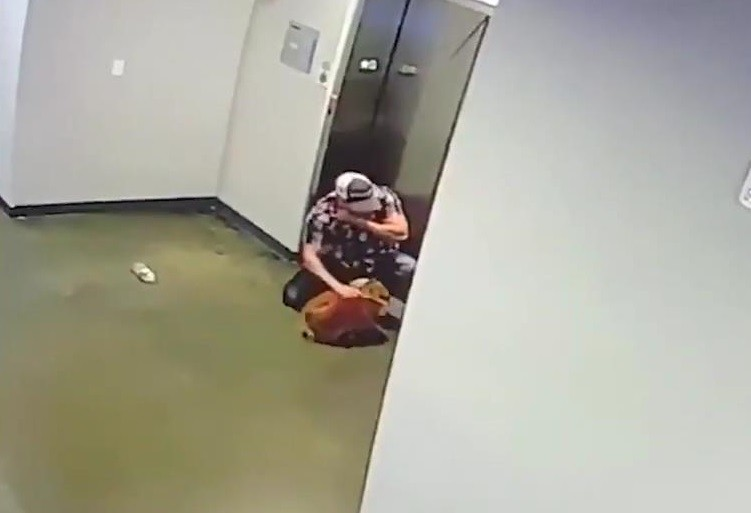 A Superman Saves Dog After Leash Gets Caught In The Elevator